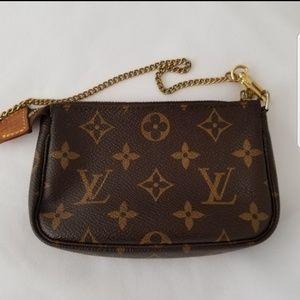 Louis Vuitton Authentic mini pochette bag
